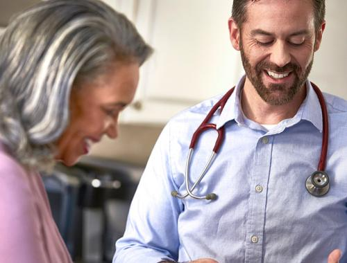 Healthcare provider teaching a patient about a medical device.