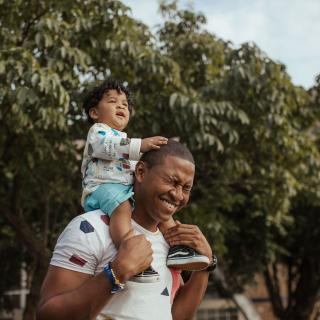 Man with his baby son on his shoulders
