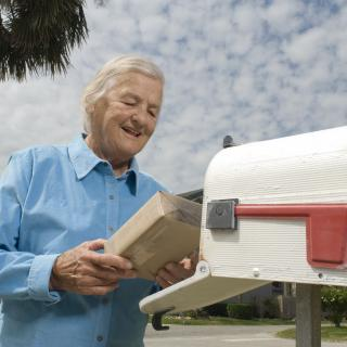 Older man holding a package