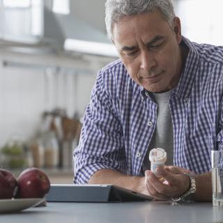 Man holding medication